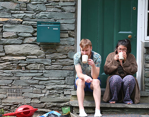 Ambleside accommodation: students sat outside the front door