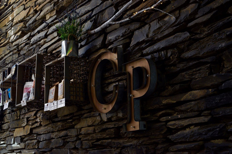 Ambleside Coffee Blog 3, Ambleside Coffee Blog: A photo of a wall which as the letters CP on it and some other storage decorations