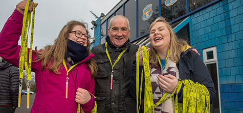 CUFC 2, A man and two woman handing out lanyards