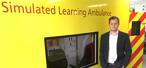 Tom Davidson with the simulated learning ambulance