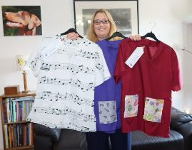 Caroline Briggs Scrubs Club , Assistive technologies officer Caroline Briggs with her musical scrubs, made as part of the university's Scrubs Club set up during the Covid19 coronavirus pandemic, May 2020