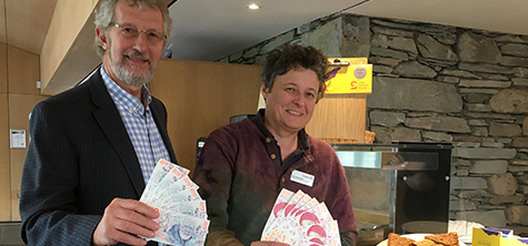 Ken Royall and director of UoC's Ambleside campus Lois Mansfield  using LD£s in the Barn café.