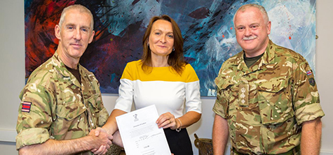 University of Cumbria Vice Chancellor Professor Julie Mennell (centre) with Lt Col Mike Brownsell and Ian Corrie
