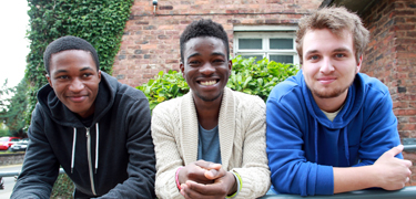 Three boys smiling