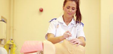 Nursing student using equipment