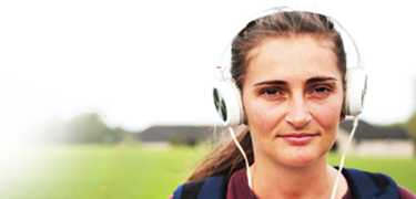 A girl with headphones on her head