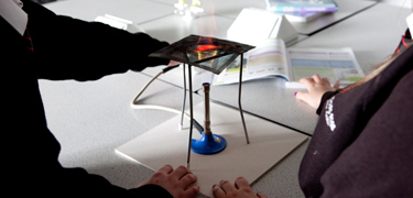 Students using Bunsen burners