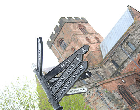 Carlisle City Centre with signpost.