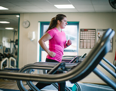 Carlisle fitness suite, woman on treadmill