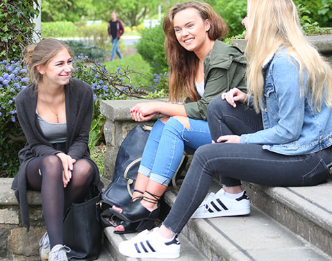 girls chatting on library steps. Original file name: _0004_SL04-BO7A3244.jpg