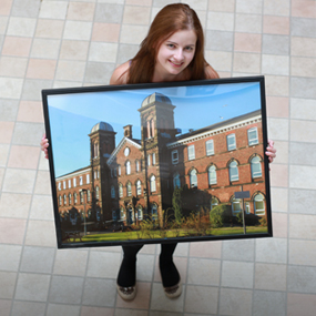 A woman holding a photo of Fusehill Street campus