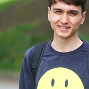 male smiling with smiley face jumper