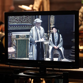 A screen with a graduation